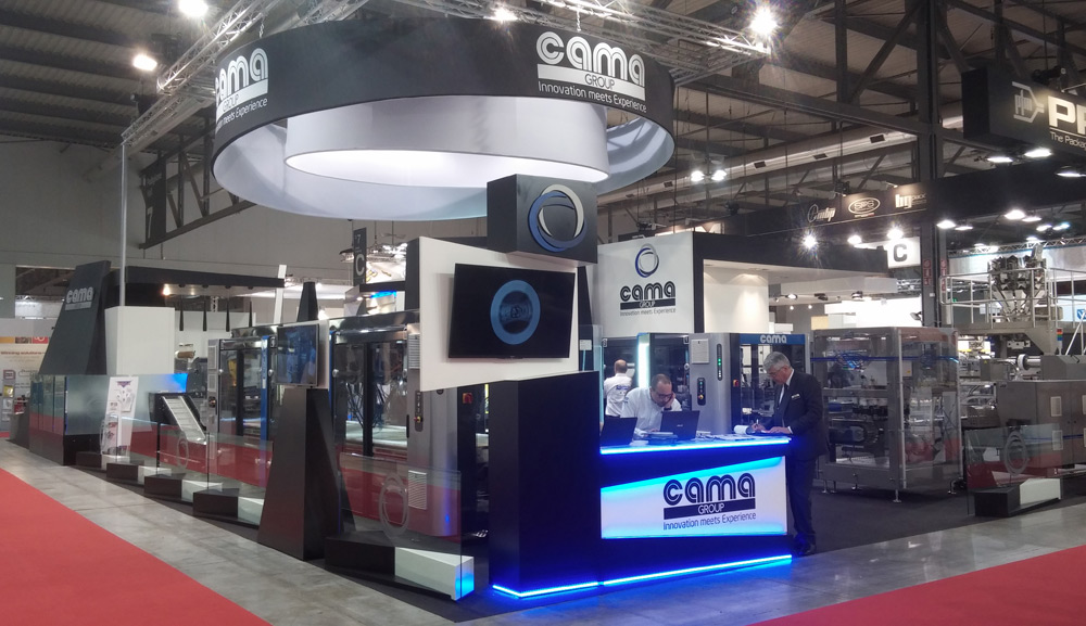 Cama at Ipack-ima 2015 in Milan: the new break-through generation secondary packaging system, with co-flow loading and anti collision patented softwares